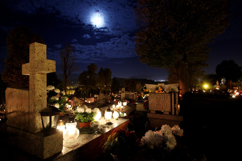 37991831 - candle flames illuminating  cemetery during all saint's day